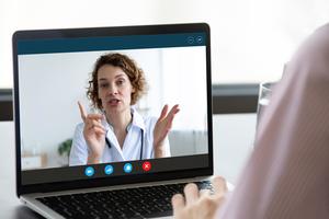 Telehealth meeting on laptop screen