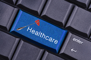 conceptual image of the healthcare key on the computer keyboard